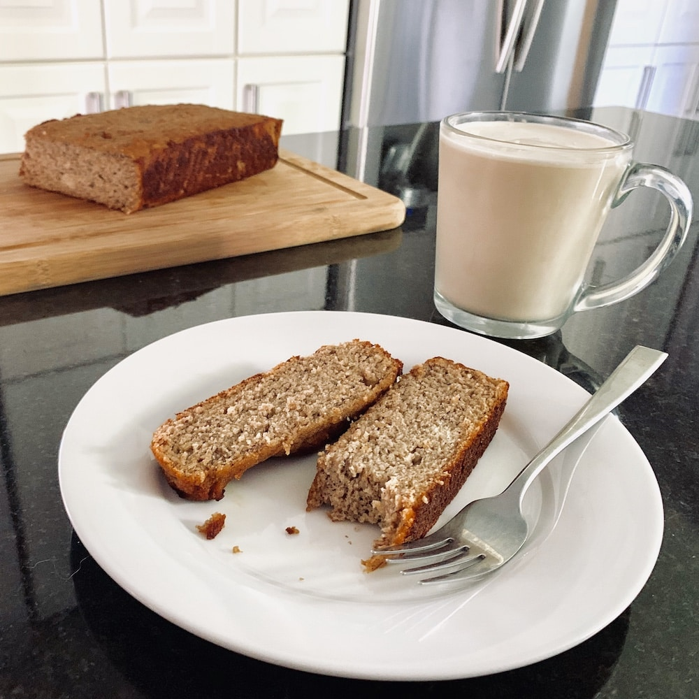 image of grain-free banana bread being enjoyed with cold brew coffee